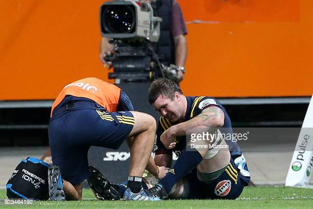 Liam Squire of the Highlanders receives treatment during the round two Super Rugby match between the Highlanders and the Blues at Forsyth Barr...