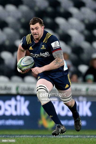 Liam Squire of the Highlanders runs the ball during the round 19 Super Rugby match between the Highlanders and the Rebels at Forsyth Barr Stadium on...