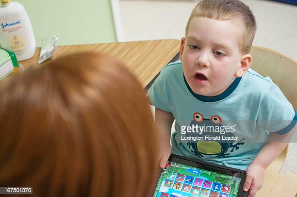 Liam Stemple works with behavioral specialist Kendra Tackett during a therapy session Thursday April 18 2013 at the Highlands Center for Autism in...