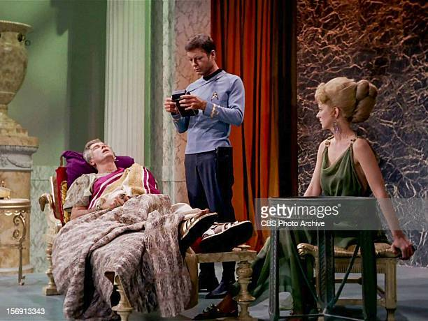 "Liam Sullivan as Parmen, DeForest Kelley as Dr. Leonard H. McCoy and Barbara Babcock as Philana in the STAR TREK episode, ""Plato's Stepchildren.""..."