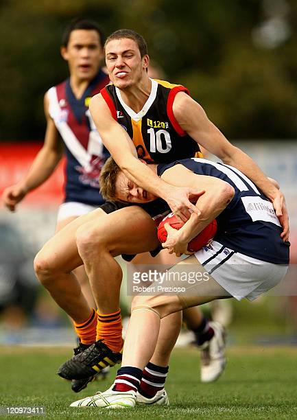 Liam Sumner of the Dragons is tackled by Nathan Wright of the Stingrays during the round 15 TAC Cup match between Dandenong and Sandringham at...