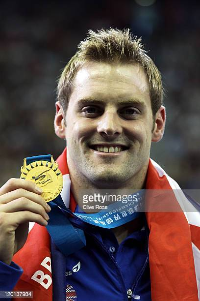 Liam Tancock of Great Britain poses with his gold medal after the Men's 50m Backstroke Final during Day Sixteen of the 14th FINA World Championships...