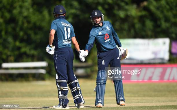 Liam Thomas shakes hands with Alex Hammond during the Vitality IT20 Physical Disability TriSeries match between England and Bangladesh at Barnards...