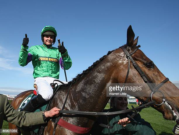 Liam Treadwell celebrates after winning the John Smith's Grand National Steeple Chase Handicap on Mon Mome at Aintree on April 4 2009 in Liverpool...