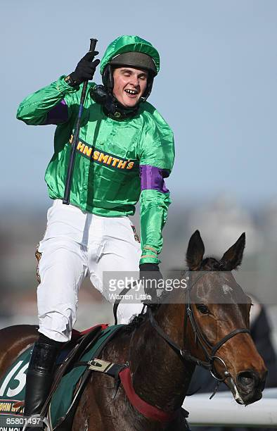 Liam Treadwell celebrates winning the John Smith's Grand National Steeple Chase Handicap at Aintree on Mon Mome on April 4 2009 in Liverpool England