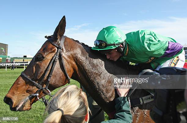 Liam Treadwell kisses Mon Mome after winning the John Smith's Grand National Steeple Chase Handicap at Aintree on April 4 2009 in Liverpool England