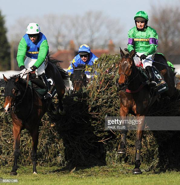 Liam Treadwell riding French horse Mon Mome jumps the last fence to win against Timmy Murphy riding his horse 'Comply or Die' during the Grand...