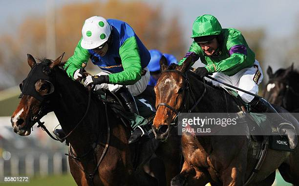 Liam Treadwell riding French horse Mon Mome runs for home to win against Timmy Murphy riding his horse 'Comply or Die' during the Grand National at...