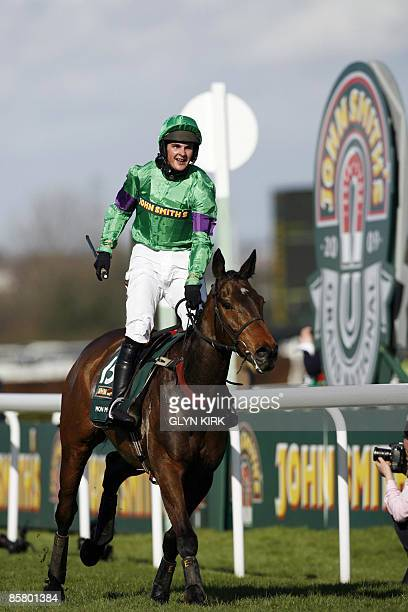 Liam Treadwell riding French horse Mon Mome runs to win during the Grand National at Aintree Racecourse in Liverpool northwest England on April 4...