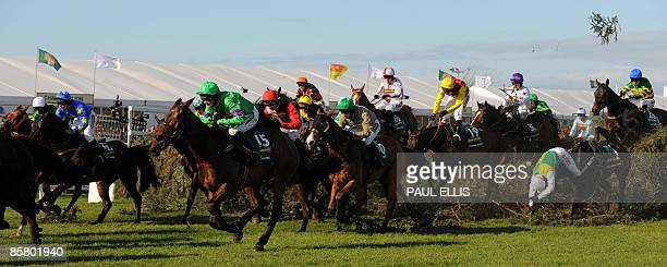REPEAT Liam Treadwell riding French horse Mon Mome runs to win during the Grand National at Aintree Racecourse in Liverpool northwest England on...
