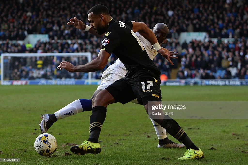 Liam Trotter of Bolton Wanderers FC and Souleymane Doukara of Leeds United FC compete for the ball during the Sky Bet Championship League match between Leeds United and Bolton Wanderers, at Elland Road Stadium on March 5, 2016 in Leeds, United Kingdom.
