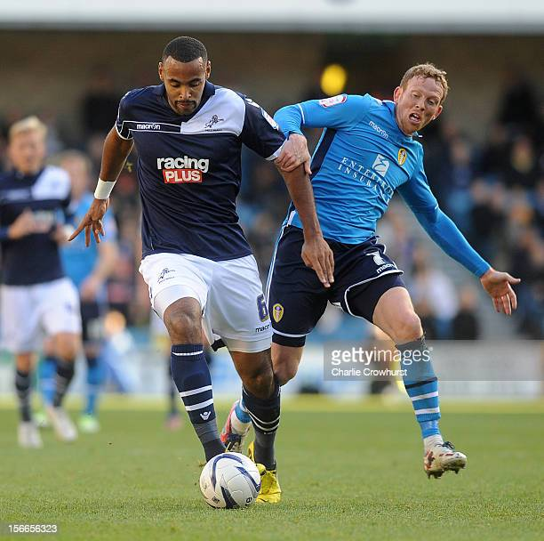 Liam Trotter of Millwall holds off Leeds' Paul Green during the npower Championship match between Millwall and Leeds United at The New Den on...