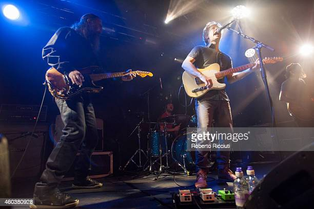 Liam Tyson Keith O'Neill John Power and Peter Wilkinson of Cast perform on stage at The Liquid Room on December 12 2014 in Edinburgh United Kingdom