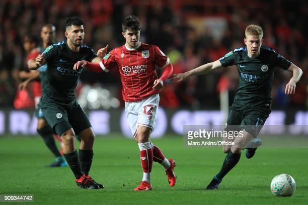 Liam Walsh of Bristol City in action with Sergio Aguero and Kevin De Bruyne of Manchester City during the Carabao Cup SemiFinal 2nd leg match between...