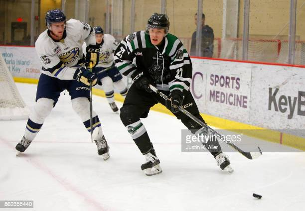 Liam Walsh of the Cedar Rapids RoughRiders goes for a puck in the corner against Colin Felix of the Sioux Falls Stampede during the game on Day 2 of...