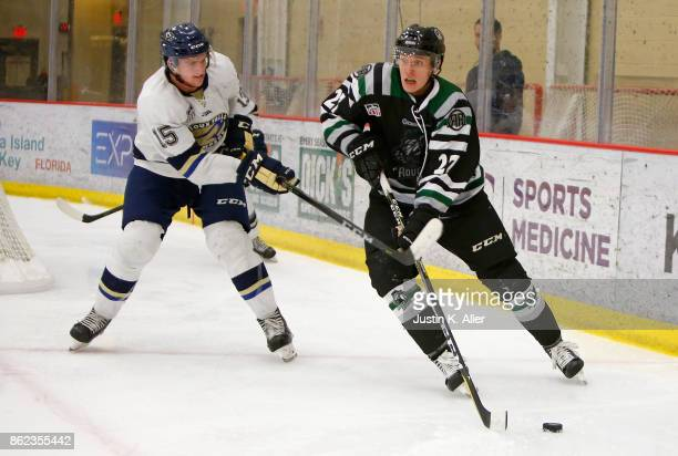 Liam Walsh of the Cedar Rapids RoughRiders skates with the puck against Colin Felix of the Sioux Falls Stampede during the game on Day 2 of the USHL...