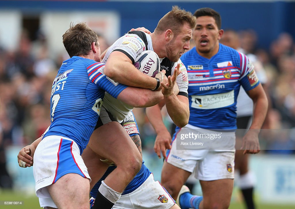 Liam Watts of Hull FC is tackled by Matty Ashurst and Tinirau Arona of Wakefield Wildcats during the First Utility Super League match between Wakefield Wildcats and Hull FC at The Rapid Solicitors Stadium on April 24, 2016 in Wakefield, England.