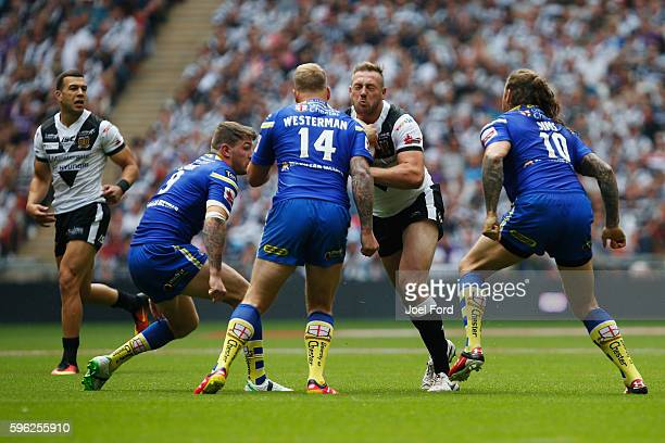 Liam Watts of Hull FC tries to break through a tackle by Joe Westerman of Warrington Wolves during the Ladbrokes Challenge Cup Final between Hull FC...