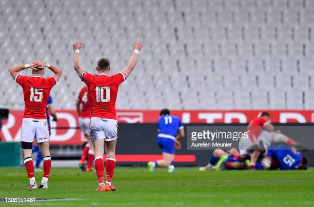 Liam Williams and Dan Biggar of Wales react to their sides third try during the Guinness Six Nations match between France and Wales at Stade de...