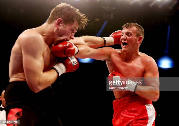 Liam Williams in action with Tyan Booth during their Middleweight bout at Liverpool Echo Arena on December 7 2013 in Liverpool England