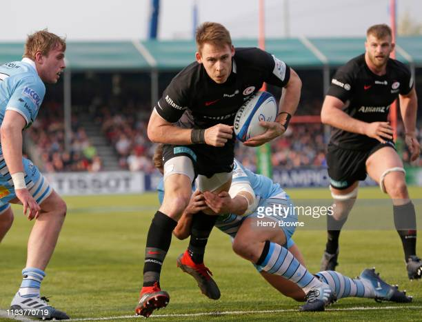 Liam Williams of Saracens avoids a tackle from Oli Kebble of Glasgow Warriors to score their fourth try during the Champions Cup Quarter Final match...