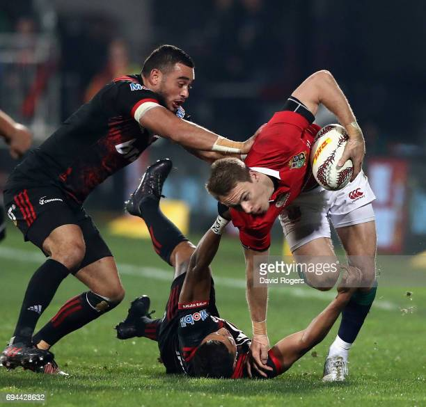 Liam Williams of the Lions is tackled by Richie Mounga and Bryn Hall during the match between the Crusaders and the British Irish Lions at AMI...
