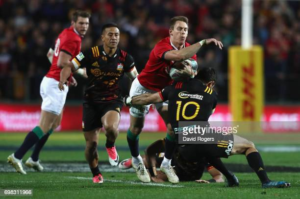 Liam Williams of the Lions is tackled by Stephen Donald during the match between the Chiefs and the British Irish Lions at Waikato Stadium on June 20...