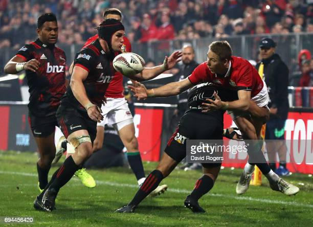 Liam Williams of the Lions spills the ball as Richie Mounga tackles during the match between the Crusaders and the British Irish Lions at AMI Stadium...