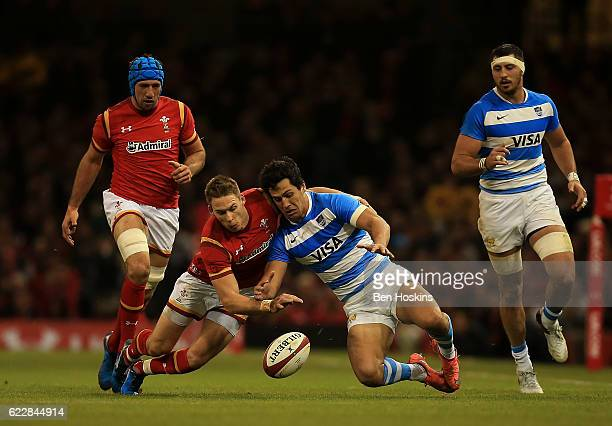 Liam Williams of Wales and Matias Moroni of Argentina battle for a loose ball during the International Match between Wales and Argentina at...