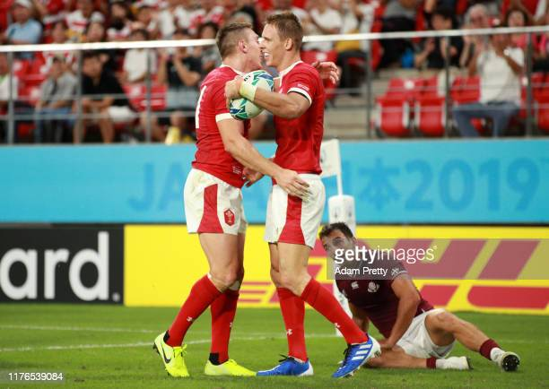 Liam Williams of Wales celebrates scoring his sides fourth try with his team mate during the Rugby World Cup 2019 Group D game between Wales and...