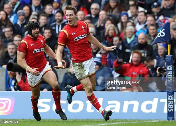 Liam Williams of Wales celebrates with teammate Leigh Halfpenny of Wales after scoring the opening try during the RBS Six Nations match between...