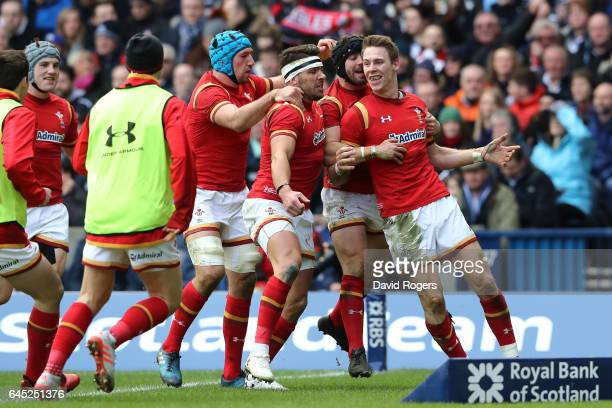 Liam Williams of Wales celebrates with teammates after scoring the opening try during the RBS Six Nations match between Scotland and Wales at...