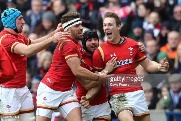 Liam Williams of Wales celebrates with teammates Leigh Halfpenny Rhys Webb and Justin Tipuric after scoring the opening try during the RBS Six...