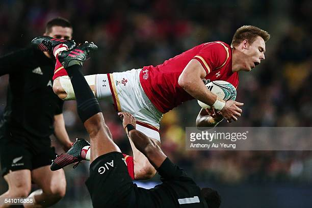 Liam Williams of Wales clashes with Waisake Naholo of New Zealand in mid air during the International Test match between the New Zealand All Blacks...