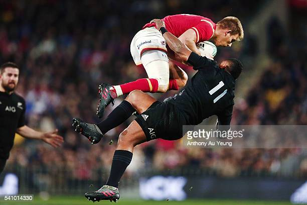 Liam Williams of Wales clashes with Waisake Naholo of New Zealand during the International Test match between the New Zealand All Blacks and Wales at...