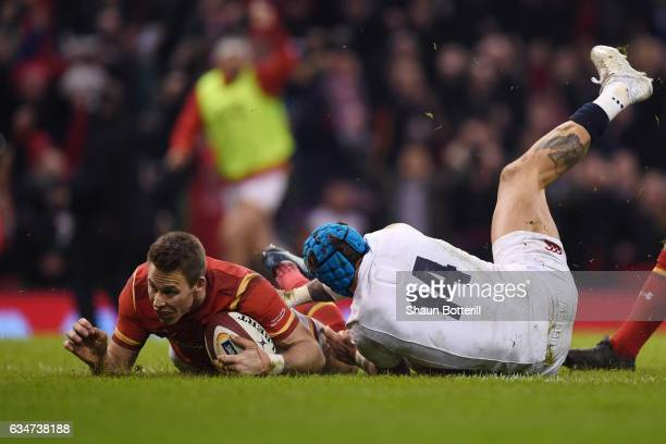 Liam Williams of Wales dives past Jack Nowell of England to score his team's first try during the RBS Six Nations match between Wales and England at...