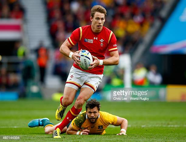Liam Williams of Wales evades a tackle by Adam AshleyCooper of Australia during the 2015 Rugby World Cup Pool A match between Australia and Wales at...