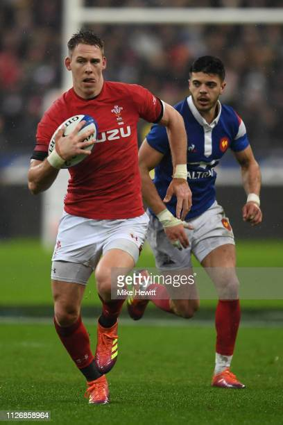 Liam Williams of Wales gets away from Romain Ntamack of France during the Guinness Six Nations match between France and Wales at Stade de France on...