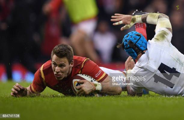 Liam Williams of Wales goes over to score his team's first try during the RBS Six Nations match between Wales and England at the Principality Stadium...