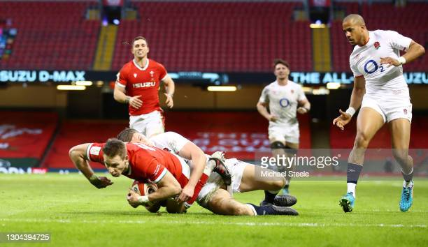 Liam Williams of Wales goes over to score their side's second try as Owen Farrell of England tackles during the Guinness Six Nations match between...