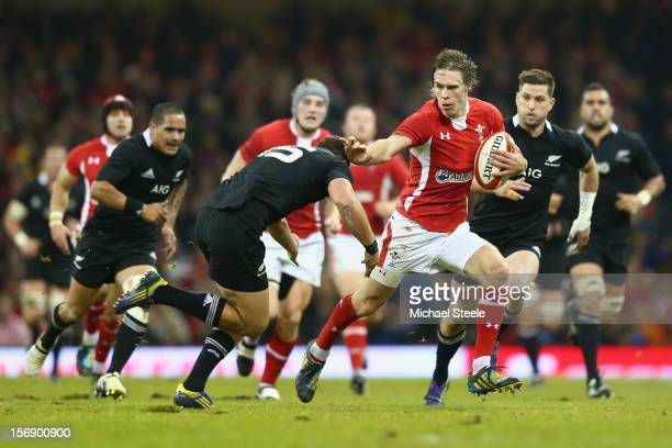 Liam Williams of Wales holds off Israel Dagg of New Zealand during the International match between Wales and New Zealand at the Millennium Stadium on...