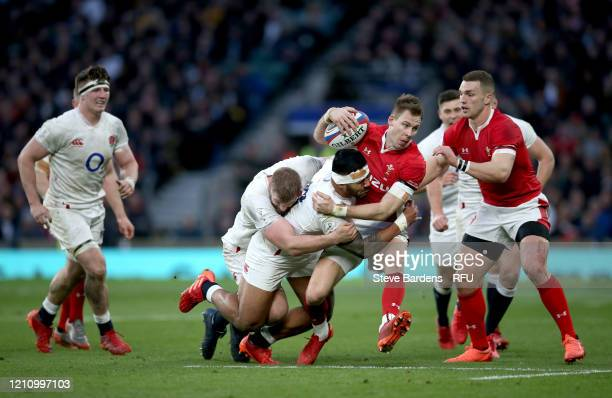 Liam Williams of Wales is ackled by Manu Tuilagi and George Kruis of England during the 2020 Guinness Six Nations match between England and Wales at...