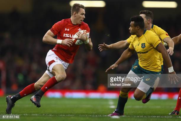 Liam Williams of Wales is closed down by Will Genia and Bernard Foley of Australia during the Autumn International between Wales and Australia at the...
