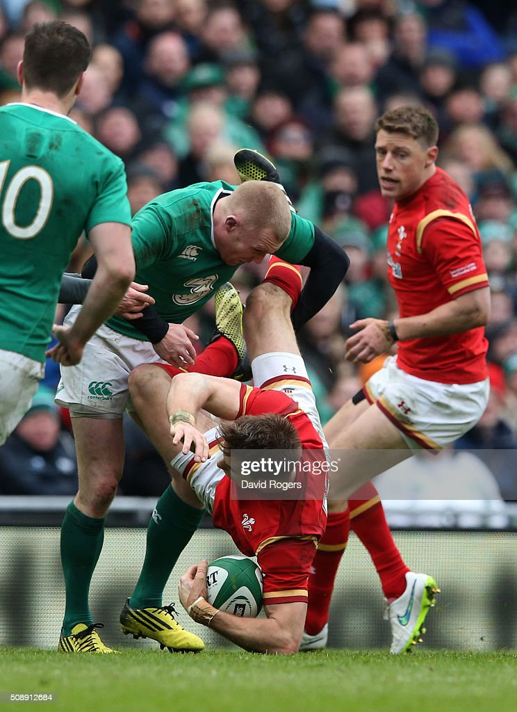 Liam Williams of Wales is dumped by Keith Earls of Ireland during the RBS Six Nations match between Ireland and Wales at the Aviva Stadium on February 7, 2016 in Dublin, Ireland.