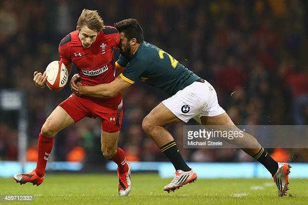 Liam Williams of Wales is tackled by Handre Pollard of South Africa during the International match betwwen Wales and South Africa at the Millennium...