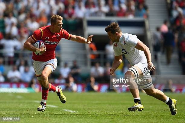 Liam Williams of Wales is tackled by Jack Clifford of England during the Old Mutual Wealth Cup between England and Wales at Twickenham Stadium on May...