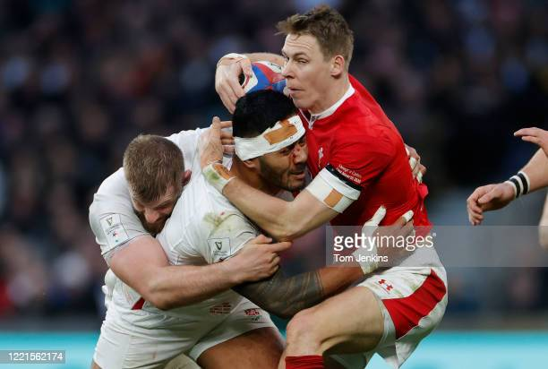 Liam Williams of Wales is tackled by Manu Tuilagi and George Kruis during the England v Wales Six Nations international rugby union match at...