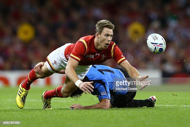 Liam Williams of Wales is tackled by Rodrigo Silva of Uruguay leading to him leaving the field during the 2015 Rugby World Cup Pool A match between...