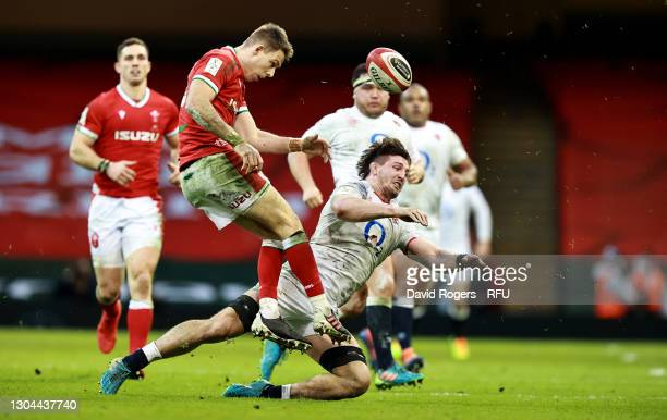 Liam Williams of Wales is tackled by Tom Curry the Guinness Six Nations match between Wales and England at Principality Stadium on February 27, 2021...