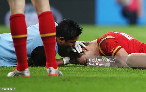 Liam Williams of Wales is treated for injury during the 2015 Rugby World Cup Pool A match between England and Wales at Twickenham Stadium on...